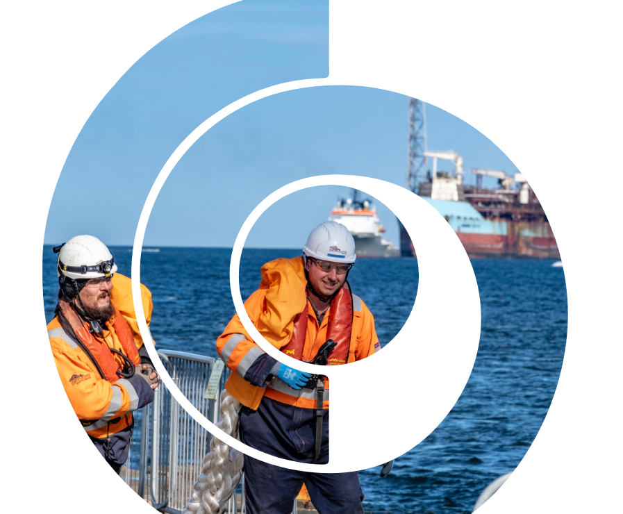 work men on the quayside within Forth and Tay Decommissioning logo